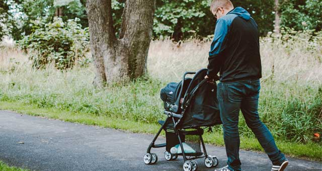 man walking with stroller